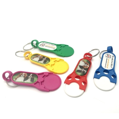 PLASTIC TROLLEY TOKENS WITH OVAL EPOXY STICKER