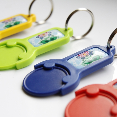 PLASTIC TROLLEY TOKENS WITH RECTANGULAR EPOXY STICKER