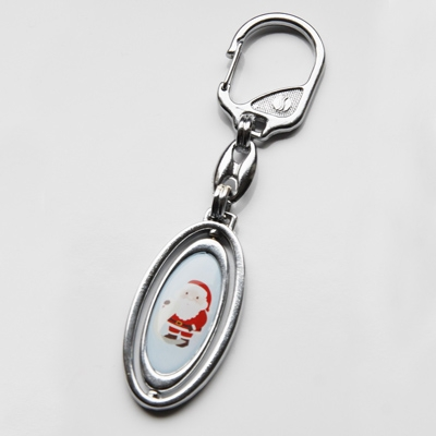 Revolting metal keychain 31x13,5mm two-sided